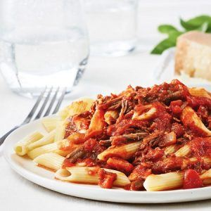 A Penne pasta with a red beef sauce over the top.
