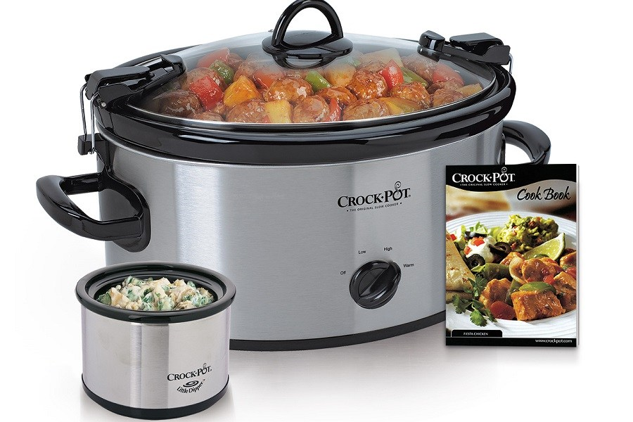 The Crock Pot Cookbook next to Slow Cooker