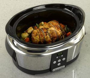 The Crockpot Next Generation Cooker slow cooking a chicken