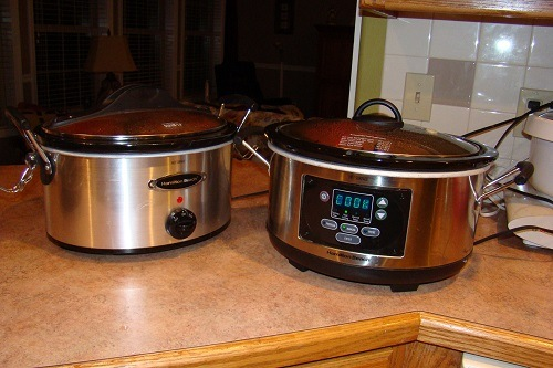 A Slow Cooker and Crock Pot on Kitchen Table
