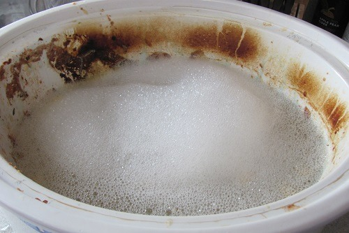 Washing Crock Pot with Soap