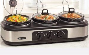 A Bella Triple Slow Cooker that is cooking bell peppers, potatoes, and meat all at the same time.