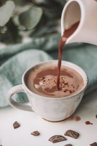 Pouring Hot Chocolate into a White Cup